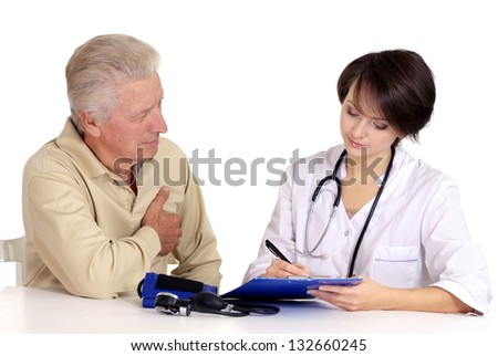 Mature man came to the reception to the young doctor - stock photo