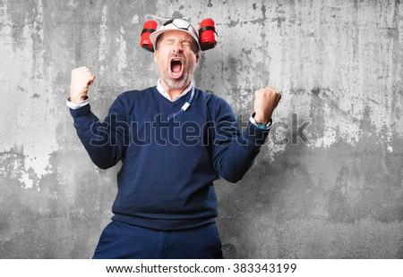 mature man cheering his soccer team - stock photo