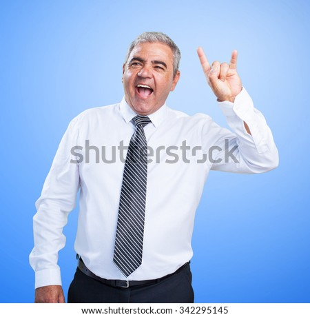 mature man doing a rock gesture