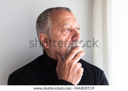 mature man dressed in black  - stock photo