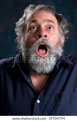 Mature man frightened by something he saw. - stock photo