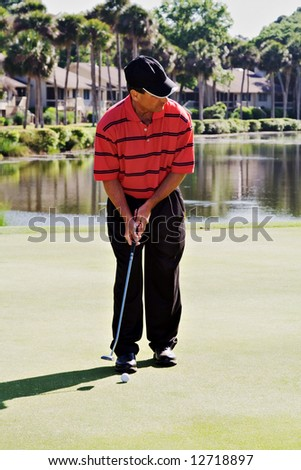 Mature man golfing in Hilton Head Island golf cours while  on vacation. - stock photo