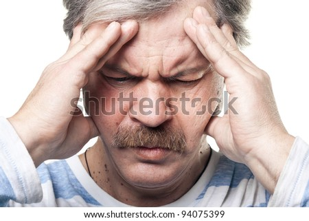 mature man having very strong pain and holding head in hands isolated on white - stock photo
