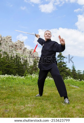 Mature Man Holding Sword Ready To Fight  - stock photo