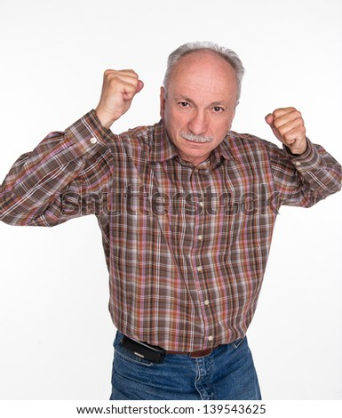 Mature man in boxer pose with raised fists on a white background