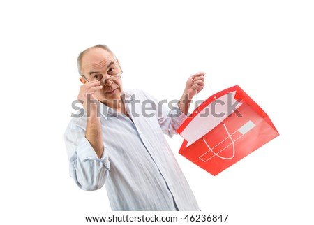 mature man in glasses hold red paperbag isolated on white