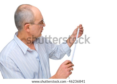 mature man in glasses with  tape-measure isolated on white - stock photo