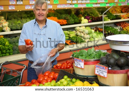 Mature man in grocery store - stock photo