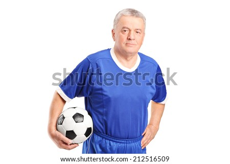Mature man in sportswear holding a football isolated on white background - stock photo