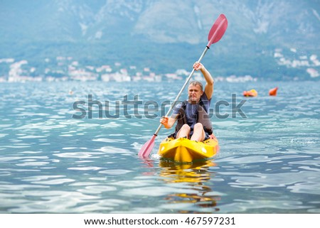 Mature man kayaking on the sea