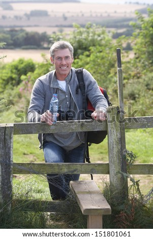 Mature Man On Country Walk - stock photo