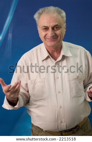 Mature man portrait. He is looking strait at the camera and gesturing - stock photo