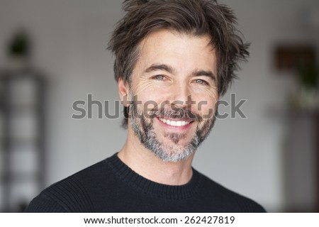 Mature Man Smiling And Having Fun - stock photo
