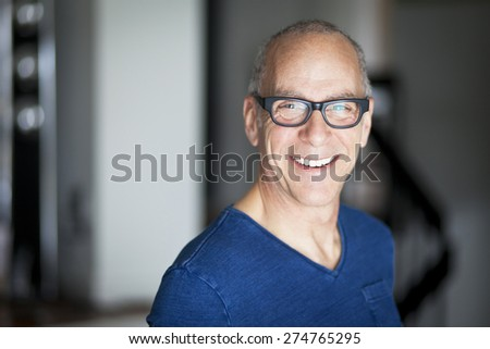 Mature Man Smiling At The Camera - stock photo
