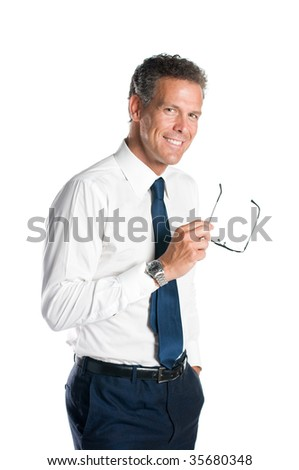 Mature man smiling while holding a pair of glasses isolated on white background - stock photo