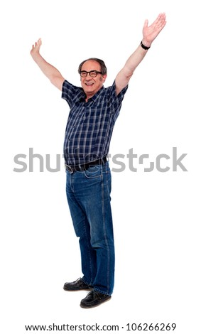 Mature man standing with open arms against white - stock photo