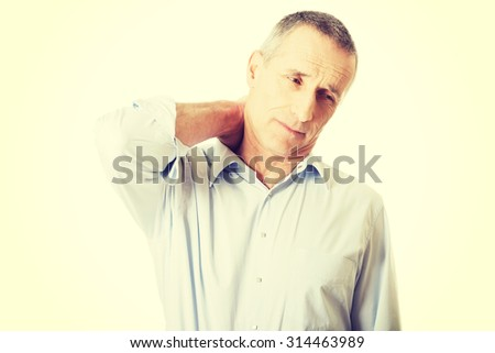 Mature man suffering from neck pain.