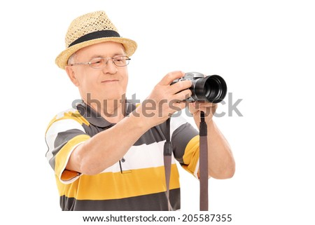 Mature man taking a picture with camera isolated on white background