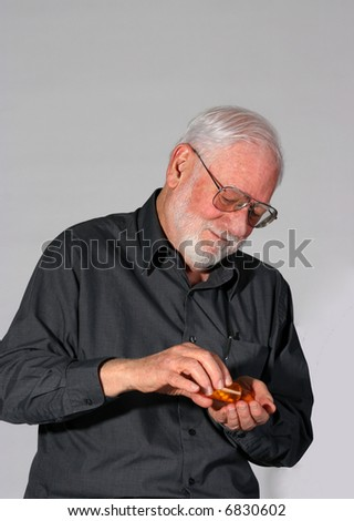 Mature man taking his drugs