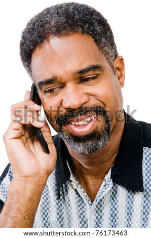 Mature man talking on a mobile phone isolated over white