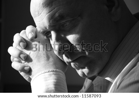 Mature man thinking in sadness. B&W. - stock photo