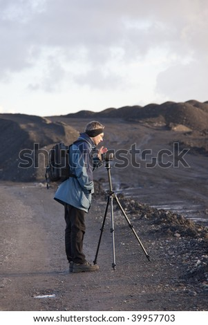 Mature Man using Camcorder, Germany - stock photo