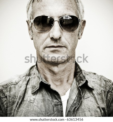 Mature man wearing sunglasses - stock photo
