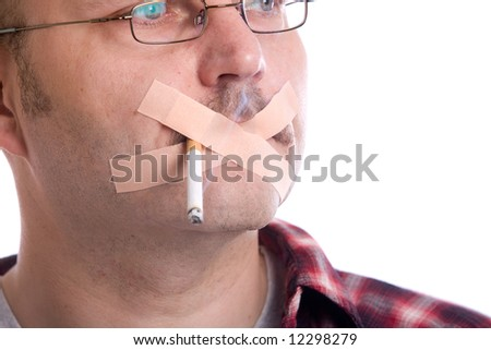 Mature man with a cigarette in his mouth and bandaids across