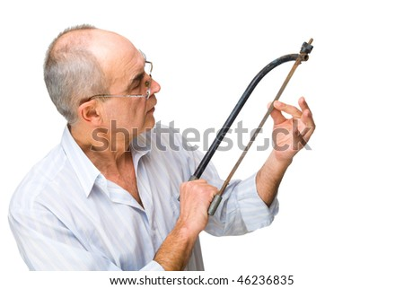 mature man with a saw in shirt thinking about repair isolated on white - stock photo