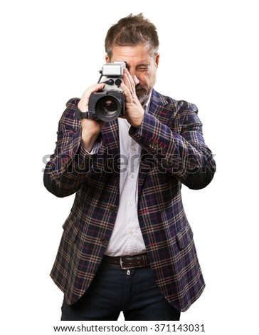 mature man with a video camera - stock photo