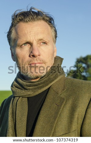mature man with beard wearing scarf - stock photo