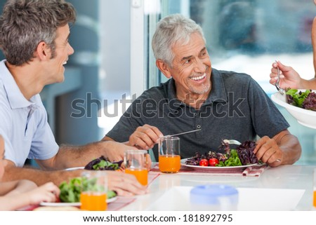 mature man with family dinner at table, home, parents, children and grandparents, happy smile lunch - stock photo