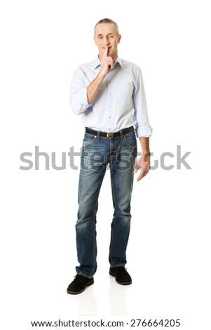 Mature man with silent gesture. - stock photo
