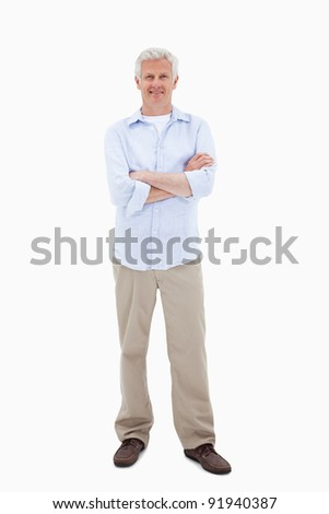 Mature man with the arms crossed against a white background - stock photo