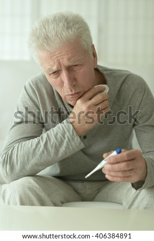 mature man with thermometer