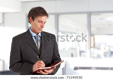 Mature man writing some notes - stock photo