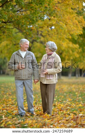 Mature married couple having fun on fresh air in autumn - stock photo