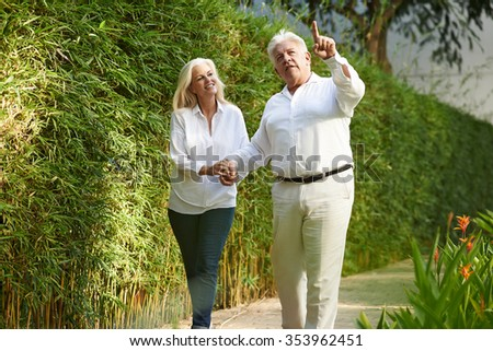 Mature married couple walking in the park