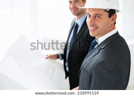 Mature men in suits with plan - stock photo