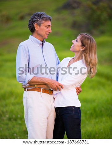 Mature middle age couple in love hugging and embracing