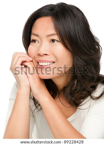 Mature middle aged Chinese Asian woman smiling looking to the side isolated on white background.