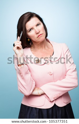 mature middle aged woman holding pen angry upset afraid sad