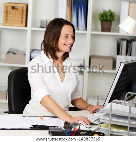 Mature office employee working in front of computer - stock photo