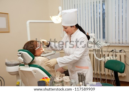 Mature patient and  dentist during dental medical treatment - stock photo