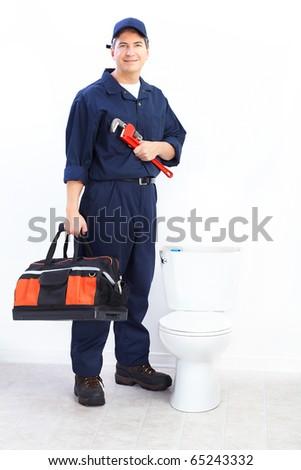 Mature plumber near a flush toilet - stock photo