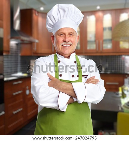 Mature professional chef man in modern restaurant - stock photo