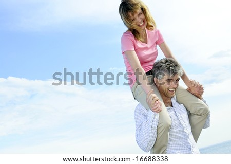 Mature romantic couple of baby boomers enjoying outdoors