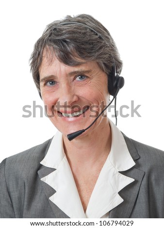 mature smiling lady with headset on white background - stock photo