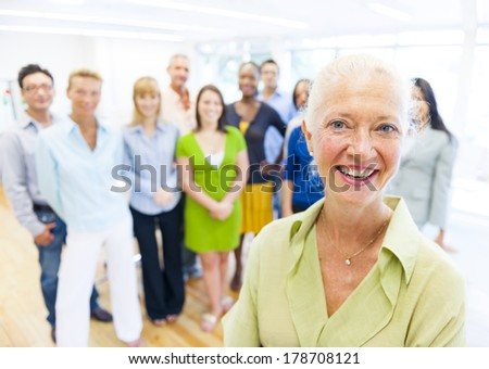 Mature Smiling Lady with World People - stock photo