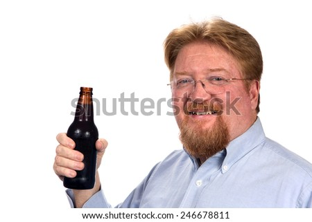 Mature smiling man holds a bottled of beer. - stock photo